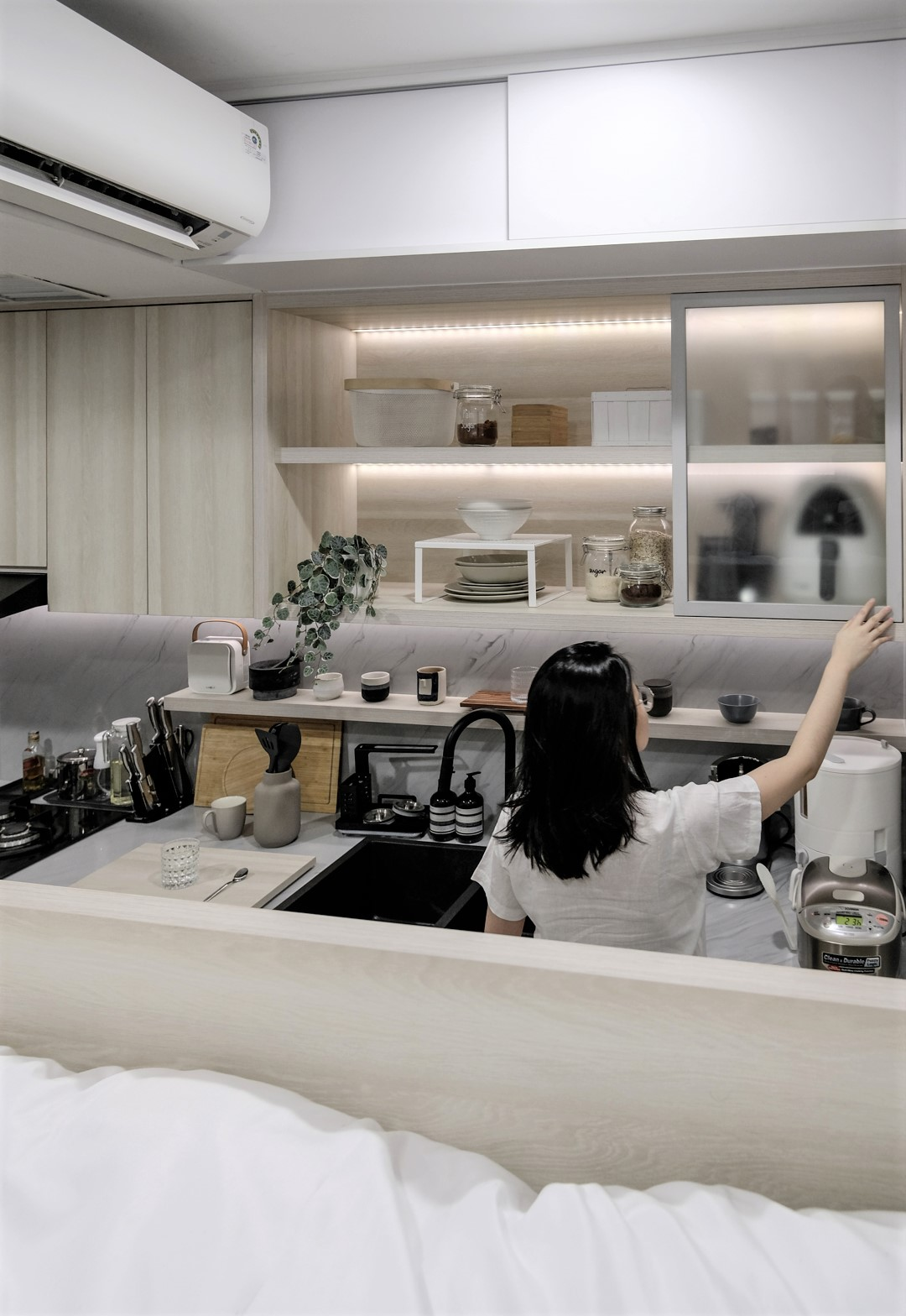 A Loft Bed With Storage Underneath Makes This Small Micro Apartment More Liveable 2